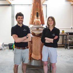 Founders Abbie & Chris with the whisky still